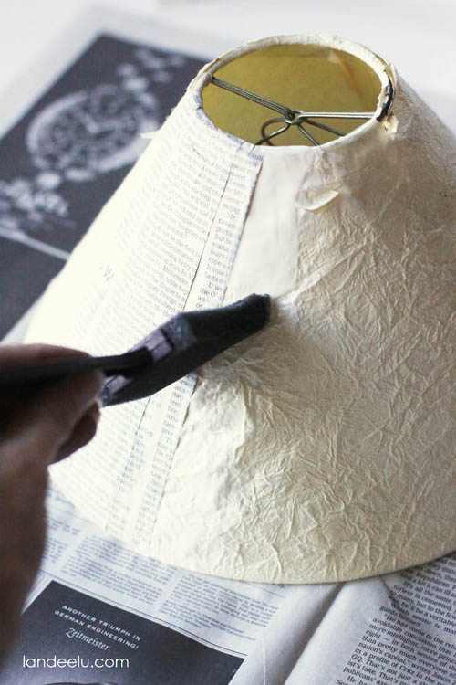 Apply Mod Podge To Lampshade Lay Strips Of Newspaper Over Podged Areas And Flatten Smooth As You Go Overlap Continue Until Entire
