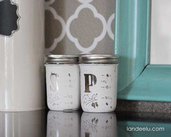 Mason Jar Salt and Pepper Shakers tutorial - a great gift idea! All you need is some paint, vinyl S & P letters, scrapbook circles, jars, mod podge, sandpaper, and paint supplies.