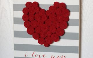 DIY Valentine's Day Sign with Felt Rosettes    landeelu.com  Such a cute sign to make for Valentine's Day this year!