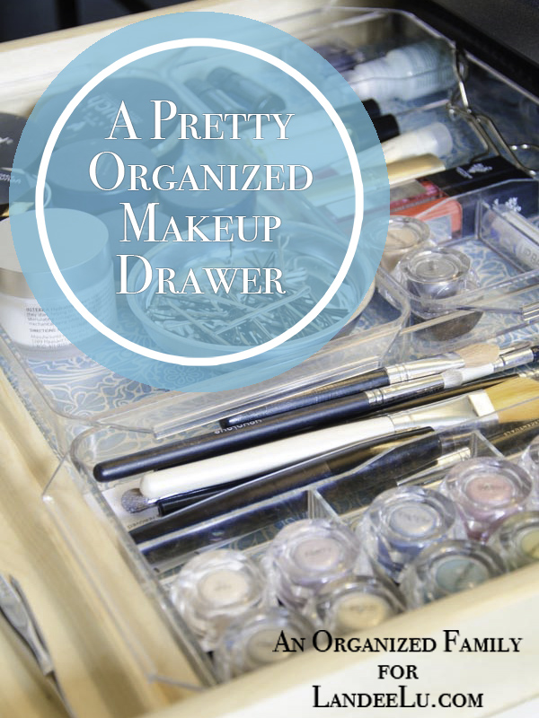 A Pretty Organized Makeup Drawer with pretty paper and acrylic tray organizers