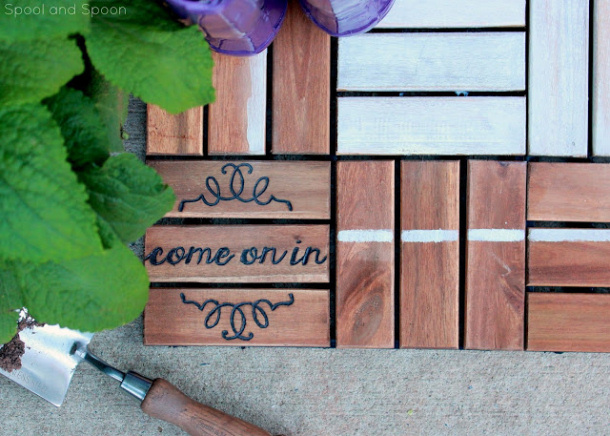 Ikea Decking tiles with words doormmat Spool and Spoon
