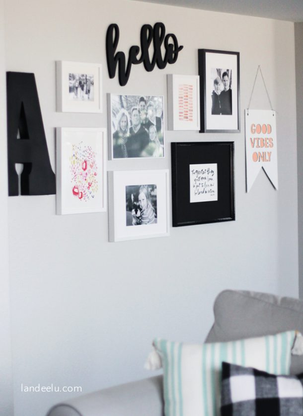 Love the black and white gallery wall with pops of color!