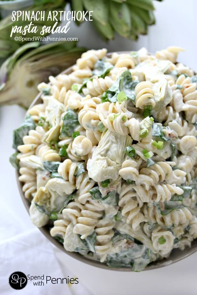 Pasta Salad Recipe - Spinach Artichoke Dip Pasta Salad Recipe is always a crowd favorite! Perfect for Potluck parties and Barbecues. Recipe via Spend with Pennies