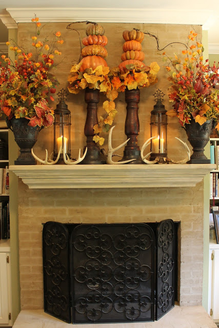Do it Yourself Masculine Fall Mantel with Lanterns, Antlers and Pumpkins Inspiration Home Decor Ideas for Autumn via Miss Kopy Kat