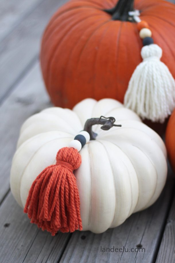 Add a fun detail to your pumpkins with DIY yarn tassels!