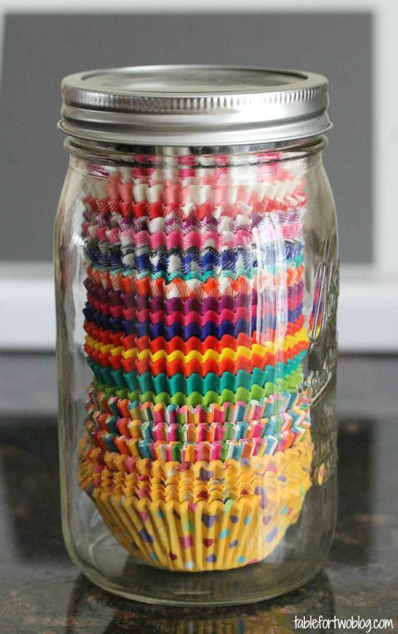 Store your cupcake liners in mason jars to keep them organized in your pantry and from getting crumpled or dusty! | Table for Two